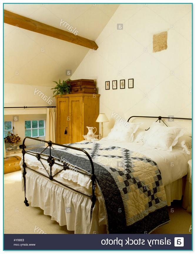 Antique White Rod Iron Bed
